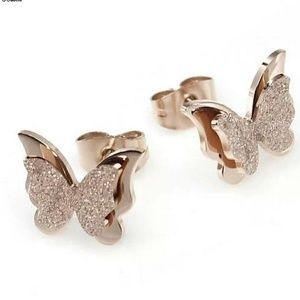 Rose gold butterfly earrings.
